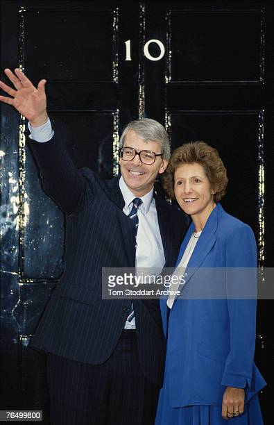 New British Prime Minister John Major poses outside Number 10 Downing Street with his wife Norma 1990