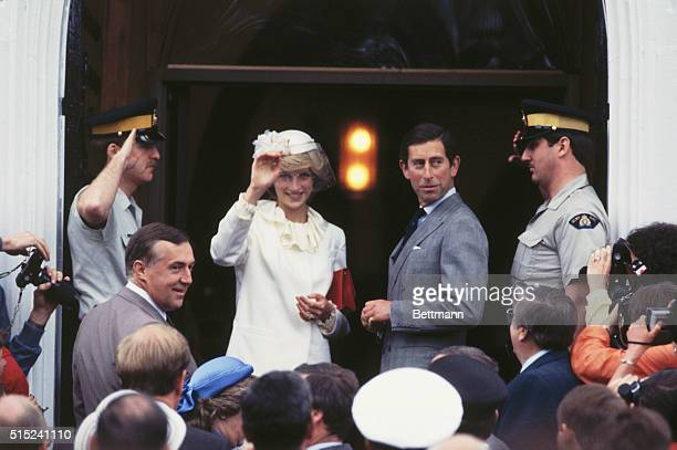Britain's Prince Charles and Princess Diana wave to a crowd that have gathered to see them as they leave a church service in New Brunswick