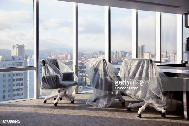 New bubble wrapped office furniture with cityscape