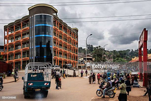 New building is erected in a Kigali popular district. Kigali, with a population of more than one million, is Rwandas capital and main city. The city...