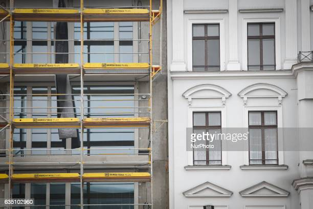 A new building is seen next to an older building in Berlin on 13 February 2017