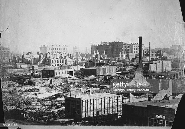 New buildings are already under construction just a few weeks after the catastrophic fire in Chicago, 1871. The view is from the corner of Randolph...
