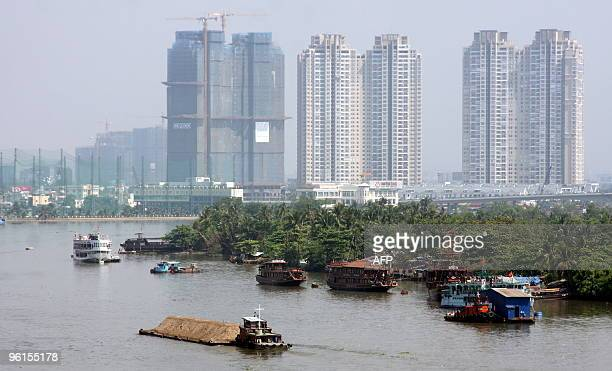 New buildings tower above boats on the Saigon river in Ho Chi Minh City on January 24 2010 Ho Chi Minh city the fast expanding economic hub in...