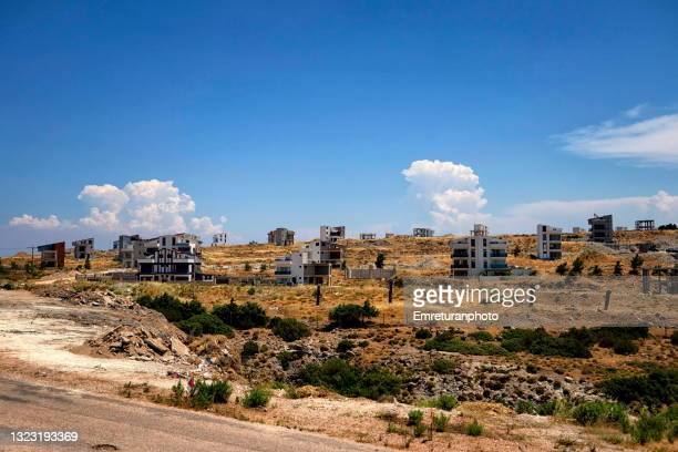 new buildings under construction in mordogan on a sunny day - emreturanphoto stock pictures, royalty-free photos & images