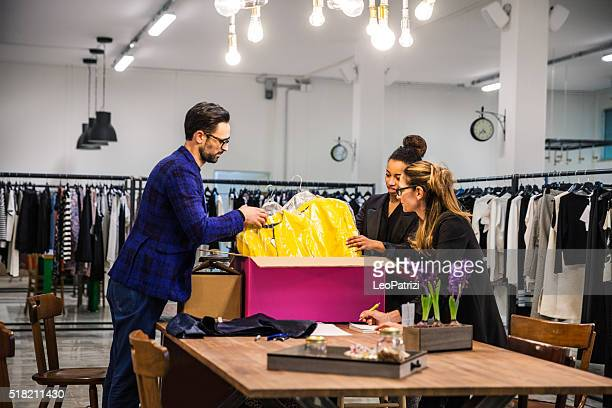 New Business clothing store, team at work on new arrivals