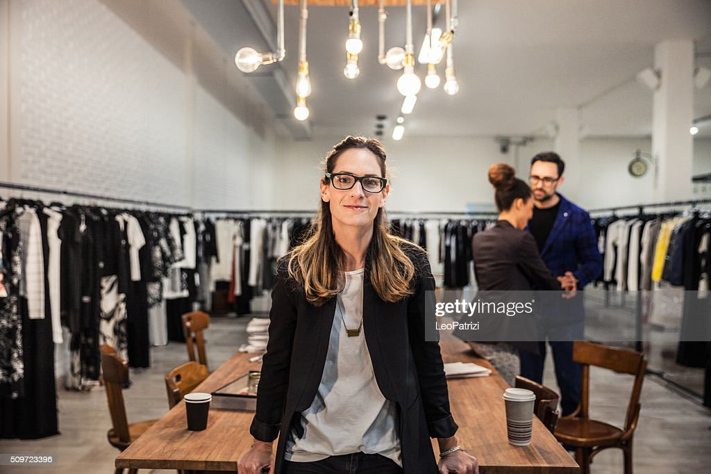 New Business employee of a clothing store : Stock Photo