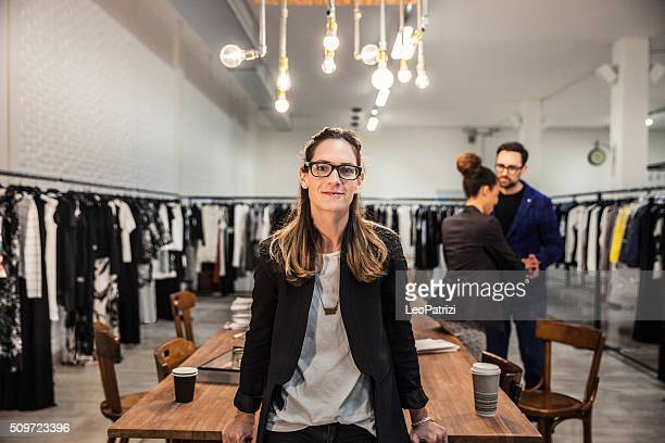 new business employee of a clothing store - showroom stock pictures, royalty-free photos & images