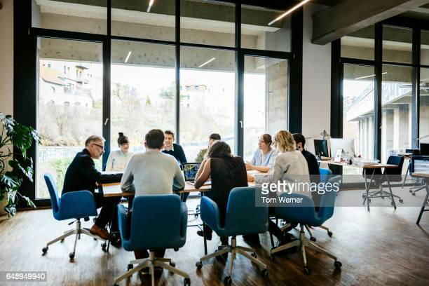 new business meeting on a conference table - business finance and industry stock pictures, royalty-free photos & images