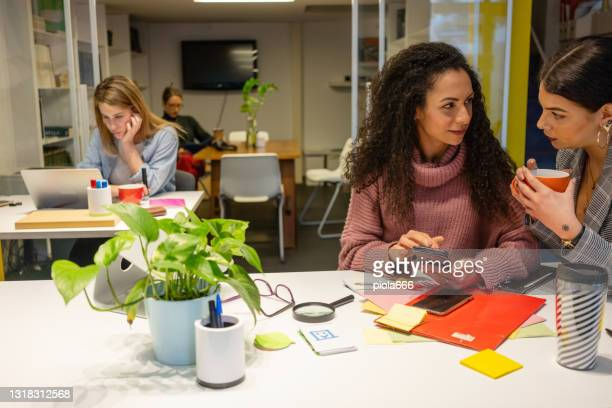 new business startup: all women team work together in coworking office - bid stock pictures, royalty-free photos & images