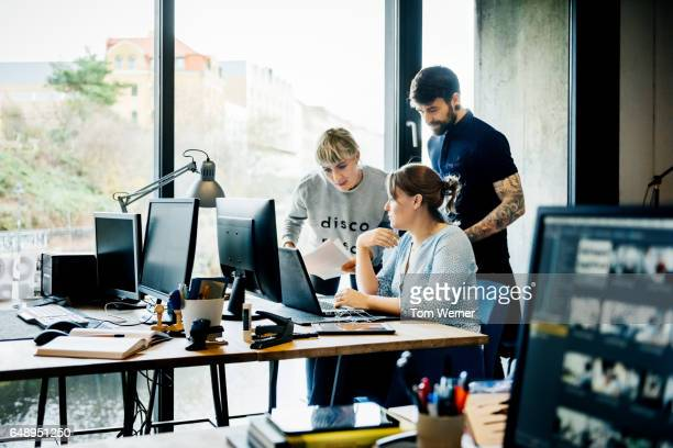 New business team discussing latest project on computer