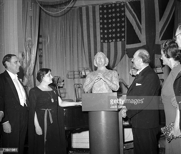 A new bust of British pianist Dame Myra Hess by British sculptor Jacob Epstein at the Savoy Hotel in London 14th July 1945 Hess organised a famous...