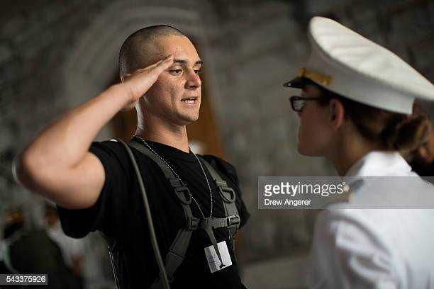 A new cadet salutes an older cadet as he receives orders during Reception Day at the United States Military Academy at West Point June 27 2016 in...