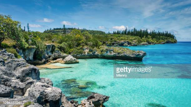 new caledonia pede bay lagoon maré island panorama tadine bay - coral sea stock pictures, royalty-free photos & images