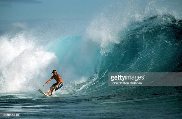 New Caledonia, surfing on the Grand Recif.
