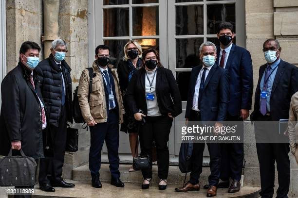 New Caledonia's delegates Sonia Backes , Pierre Frogier from 'Avenir en confiance' political group arrive ahead of a meeting with French Prime...