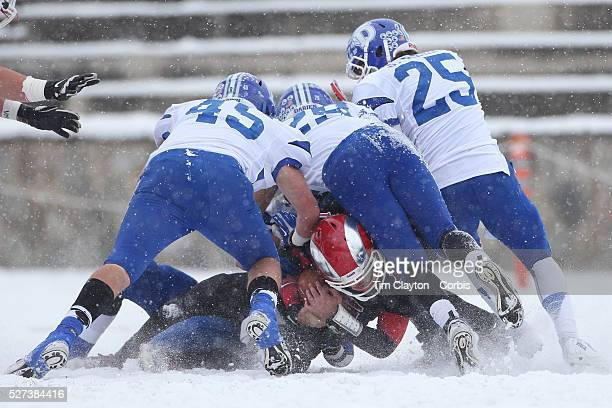 New Canaan quarterback Nick Cascione is tackled during the New Canaan Rams Vs Darien Blue Wave CIAC Football Championship Class L Final at Boyle...