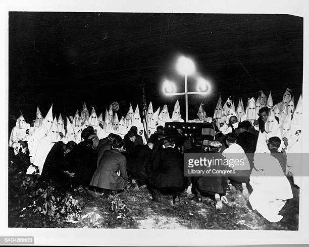 New candidates attend a Ku Klux Klan initiation ceremony, ca. 1920s.