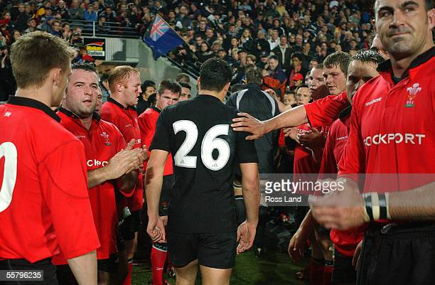 New Cap Dan Carter is clapped from the field by Welsh players following the New Zealand V Wales rugby union match in Hamilton, New Zealand, Saturday....