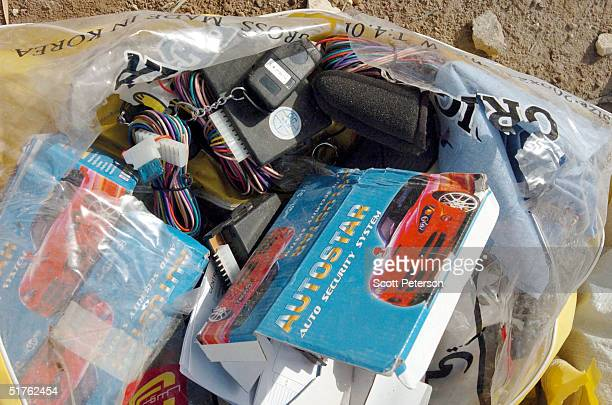 New car alarms which can be used as detonators sit in a bag as part of a large weapons cache found in Fallujah on the compound of an Islamic charity...