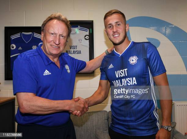 New Cardiff City signing Will Vaulks poses with manager Neil Warnock at Cardiff City Stadium on June 27, 2019 in Cardiff, United Kingdom.