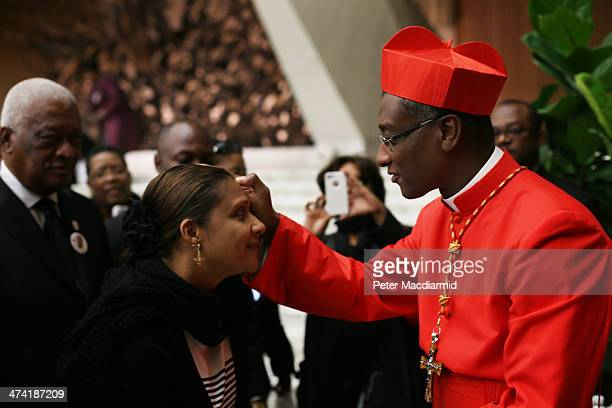 New Cardinal Chibly Langlois greets visitors in the Paul VI Audience Hall on February 22 2014 in Vatican City Vatican 19 new cardinals were created...