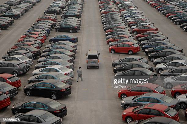 New cars are seen at a parking lot of Changan Ford Mazda Automobile Co Ltd Ford Motor's joint venture in China in Chongqing Municipality February 9...