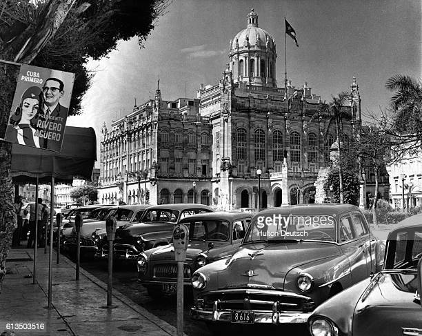 New cars line the street outside the Presidential Palace in Havana Cuba in September 1958 The palace was the official residence of dictator Fulgencio...