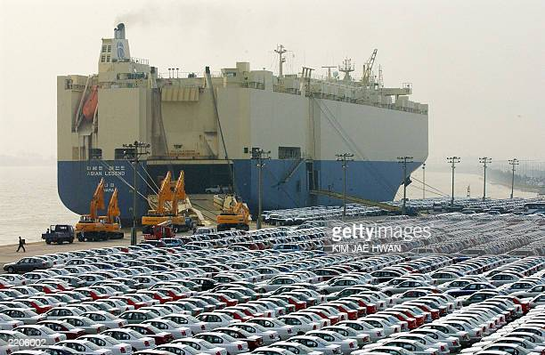 New cars produced by South Korea's leading Hyundai Motor Co for exports await shipment in the southeastern port city of Ulsan 20 June 2003 Hyundai...