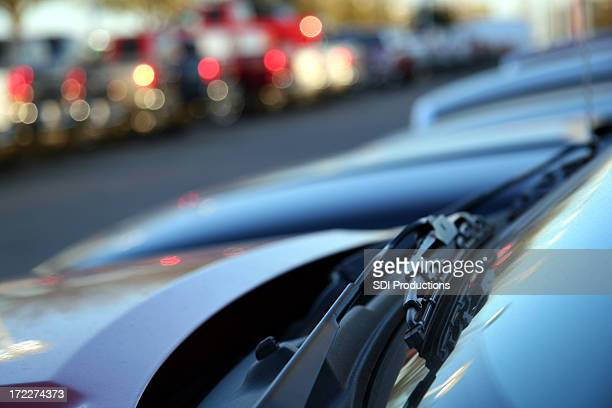 new car's windshield wiper at a car lot. - windshield wiper stock photos and pictures