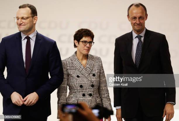 New CDU leader Annegret KrampKarrenbauer and Jens Spahn and Friedrich Merz acknowledge delegates after the vote to elect the next leader of the...