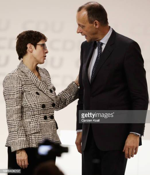 New CDU leader Annegret KrampKarrenbauer talks with Friedrich Merz after the vote to elect the next leader of the German Christian Democrats at a...