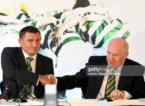 New Celtic Manager Tony Mowbray shakes hands with chairman John Reid during a press conference at Celtic Park Glasgow
