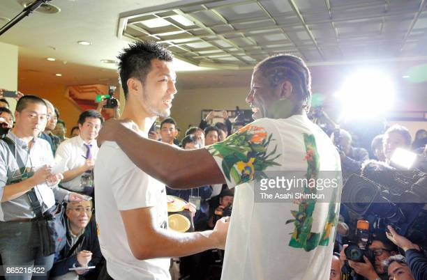 New champion Ryota Murata of Japan is embraced by Hassan N'Dam of France during a press conference after their WBA Middleweight Title Bout at Ryogoku...