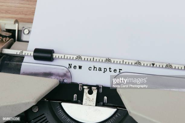 new chapter typed on vintage typewriter - beginnings stock pictures, royalty-free photos & images