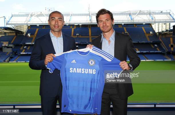 New Chelsea first team assistant coach Roberto Di Matteo and new Chelsea manager Andre VillasBoas hold a Chelsea shirt pitchside after a press...