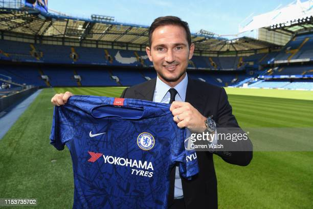 New Chelsea Head Coach Frank Lampard holds the home Chelsea FC shirt after press conference at Stamford Bridge on July 4 2019 in London England