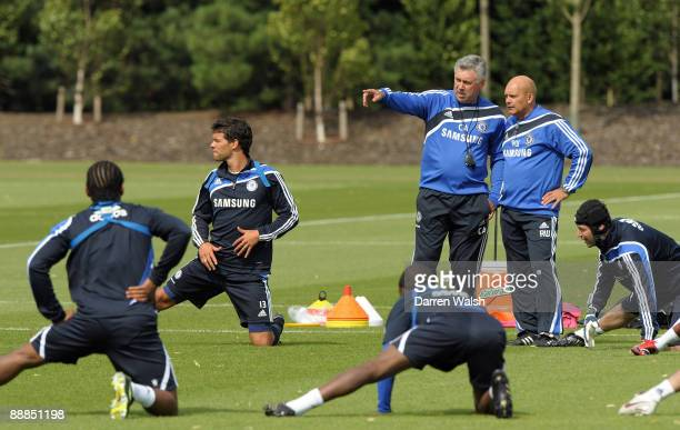 New Chelsea manager Carlo Ancelotti and Ray Wilkins with Michael Ballack during a training session at Cobham Training ground on July 6, 2009 in...