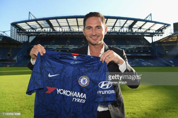 New Chelsea manager Frank Lampard holds the Chelsea shirt as he is announced as new manager of Chelsea FC at Stamford Bridge on July 3 2019 in London...