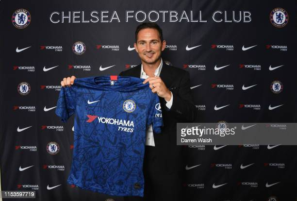 New Chelsea manager Frank Lampard holds the home shirt as he is announced as new manager of Chelsea FC at Stamford Bridge on July 3 2019 in London...