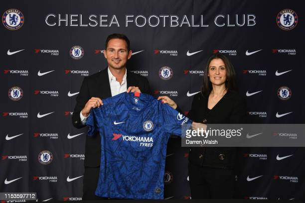 New Chelsea manager Frank Lampard holds the home shirt with Director of Chelsea Marina Granovskaia as he is announced as new manager of Chelsea FC at...