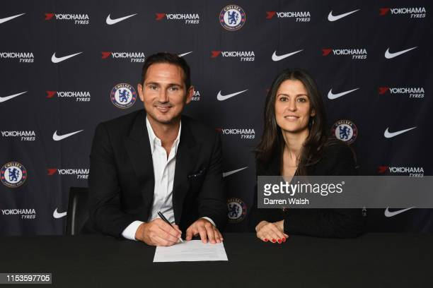 New Chelsea manager Frank Lampard signs his contract with Director of Chelsea Marina Granovskaia as he is announced as new manager of Chelsea FC at...
