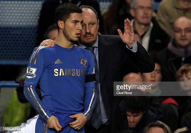 New Chelsea manager Rafael Benitez speaks with Eden Hazard of Chelsea during the Barclays Premier League match between Chelsea and Manchester City at...