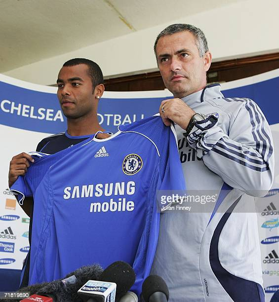 New Chelsea signing Ashley Cole and manager Jose Mourinho pose for photos before a press conference at the Chelsea training ground on September 8...