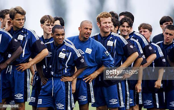 New Chelsea signing Gianluca Vialli looks on with team mates during a training session after signing from Juventus Circa July 1996 in London England