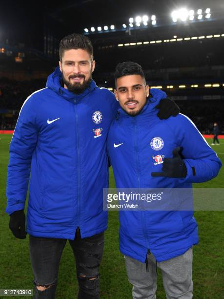 New Chelsea signings Olivier Giroud of Chelsea and Emerson Palmieri of Chelsea pose for a photo pitch side prior to the Premier League match between...