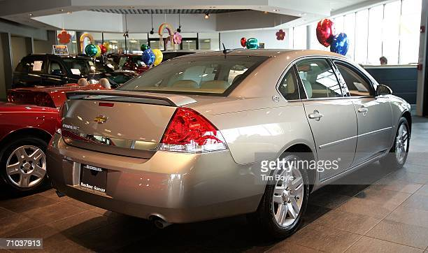 A new Chevrolet Impala is seen at Bredemann Chevrolet May 24 2006 in Park Ridge Illinois General Motors has offered gas reimbursement for automobiles...