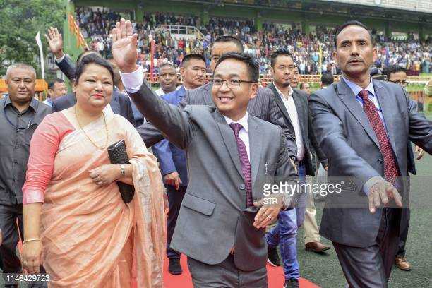 New Chief Minister of Sikkim Prem Singh Golay waves to the crowd at Gangtok on May 27 2019