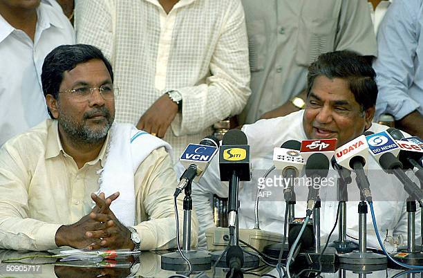 New Chief Minister of the Indian state of Karnataka and Congress Party leader Dharam Singh addresses media representatives as new deputy Chief...