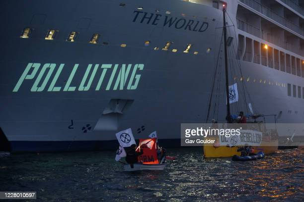 New Climate Change movement, Ocean Rebellion protest in Falmouth Harbour in Cornwall on the 11th August 2020 in Falmouth, United Kingdom. At sun down...