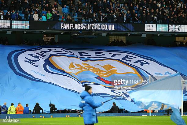 A new club badge design is displayed by fans during the Barclays Premier League match between Manchester City and Sunderland at the Etihad Stadium on...